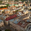 LVOV, UKRAINE - AUG 8: Top view from Lviv City Hall - building city administration of the city currently open the view point for tourists, Aug 8, 2012 in Lvov, Ukraine. Tower was built in 1827-1835. — Stockfoto