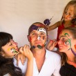 Happy family - children paints face of his father — ストック写真