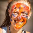 Portrait of an emotional young girl with paint on his face — Stock Photo