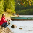 Stockfoto: Teen-girl near the river in summer.