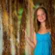Teengirl in a blue dress in mangrove forest — Stockfoto