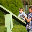 Father with his son on the sportsground — ストック写真