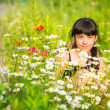 Little girl portrait among wildflowers. — Stock fotografie