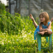 Portrait of little girl in the yard of a country house — ストック写真