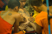 NAKHON CHAI, THAILAND - MAR 23: Unidentified monk makes traditional Yantra tattooing during Wai Kroo Master Day Ceremony in Wat Bang Pra on Mar 23, 2013 in Nakhon Chai, Thailand. — Stock Photo