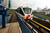 KUALA LUMPUR, MALAYSIA - MAR 30: Monorail train on Mar 30, 2013 in Kuala Lumpur, Malaysia. KL Monorail opened on 31 August 2003, and serves 11 stations running 8.6 km. — Stock Photo