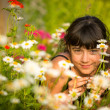 Girl portrait among wildflowers — Stock Photo