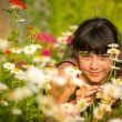 Stock Photo: Girl portrait among wildflowers