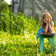 Little girl in the yard — Stok fotoğraf