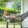Young girl lies in the hammock — Stock Photo