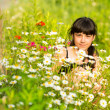 Portrait girl among wildflowers — Stock fotografie