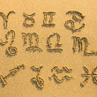 Set of zodiac signs (drawn on the facture beach sand) — Foto de Stock