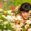 Portrait teengirl among wildflowers — Stock fotografie