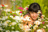 Portrait teengirl among wildflowers — Stok fotoğraf