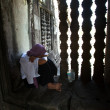 Stock Photo: Unidentified cambodiwomin Angkor Wat