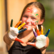 Little girl with hands in the paint — Stok fotoğraf