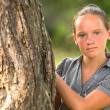 Portrait of young pretty teen-girl in the park — Stock Photo #30174253