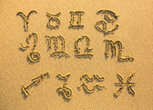 Set of zodiac signs drawn on the facture beach sand — Zdjęcie stockowe