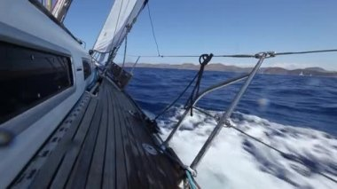 Sailing boat shot in full HD at the Saronic Gulf, Greece. Sailing in the wind through the waves (HD) — Stock Video