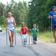 Participants (kids: Nikolay Dubinin 4, Darja Zhochkina 6) during of local competitions in Nordic walking devoted to the Day of Health — Stock Photo