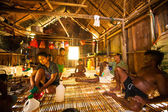 Unidentified people Orang Asli in his house — Stock Photo