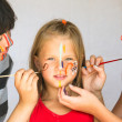 Стоковое фото: Two girl playing with painting with little sister.
