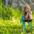 Portrait of charming little girl in the yard of a country house — ストック写真