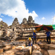 Stock Photo: Unidentified cambodiworkers for restoration works in Angkor Wat
