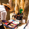 An unidentified cambodian street picture seller in Angkor Wat — Stock Photo