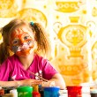 Stock Photo: Little child drawing paint with paint of face.