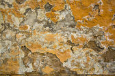 Texture paint on a crumbling of the old stucco wall stone house. — Stock Photo