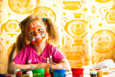 Little child drawing paint with paint of face. — Stock Photo