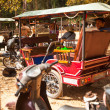 Stock Photo: Unidentified cambodimoto-rickshaws in Angkor Wat