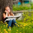 Tired school girl in park with books — Foto de stock #31185837