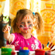 Стоковое фото: Little child, drawing paint with paint of face.