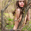 Fashion portrait of young naked woman in the forest — Stock Photo