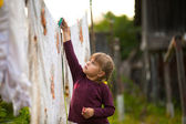 Sweet five-year girl with the clothesline — Stock Photo