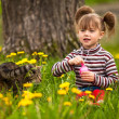 Стоковое фото: Funny lovely little girl playing with cat
