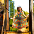 Stock Photo: Beautiful little five-year girl posing for cameron porch of village house at sunset