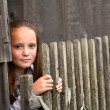 Beautiful teen-girl standing near vintage rural fence. — Foto Stock