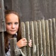 Beautiful teen-girl standing near vintage rural fence. — Lizenzfreies Foto