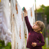 Lovely little five-year girl with clothespin outdoor — Stock Photo