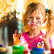 Little funny kid drawing paint with paint of face — Stock Photo #31783359