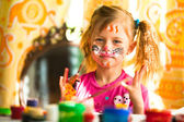 Little funny kid drawing paint with paint of face — Stock Photo
