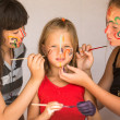 Two girl playing with painting with sister. — Stockfoto