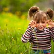 Funny lovely little five-year girl in park. — Стоковая фотография