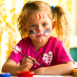 Child, drawing paint with paint of face. — Stok Fotoğraf #32256879