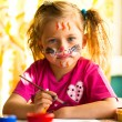 Child, drawing paint with paint of face. — Stock Photo