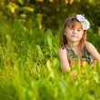 Funny lovely little girl in park — Foto Stock #32256947