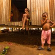 Постер, плакат: Unidentified children Orang Asli in his village